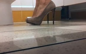 Milf with high heels in the WC