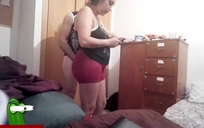 He fucks her from behind before putting clothes on